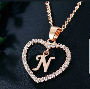 New gold tone letter N necklace